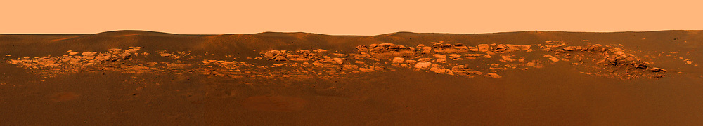 This high resolution image captured by the Mars Exploration Rover Opportunity's panoramic camera highlights the puzzling rock outcropping that scientists eagerly wait to investigate. These layered rocks measure only 10 centimetres (4 inches) tall and are thought to be either volcanic ash deposits or sediments carried by water or wind.