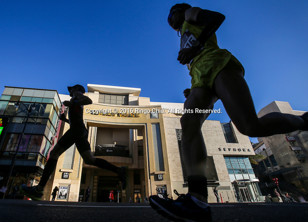 Runner make their way along Hollywood Boulevard during the 31st Los Angeles Marathon in Los Angeles, Sunday, Feb. 14, 2016. The 26.2-mile marathon started at Dodger Stadium and finished at Santa Monica.  (Photo by Ringo Chiu/PHOTOFORMULA.com)<br /> <br /> Usage Notes: This content is intended for editorial use only. For other uses, additional clearances may be required.