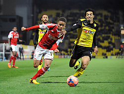 Bristol City's Bobby Reid is challenged by Watford's Iriney - Photo mandatory by-line: Dougie Allward/JMP - Tel: Mobile: 07966 386802 14/01/2014 - SPORT - FOOTBALL - Vicarage Road - Watford - Watford v Bristol City - FA Cup - Third Round - replay