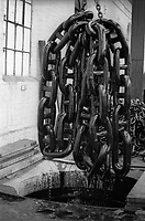Large chain drying after being dipped and finishes at Griffin Woodhouse Chainmaking  in the Black Country West Midlands UK  in the 1970's