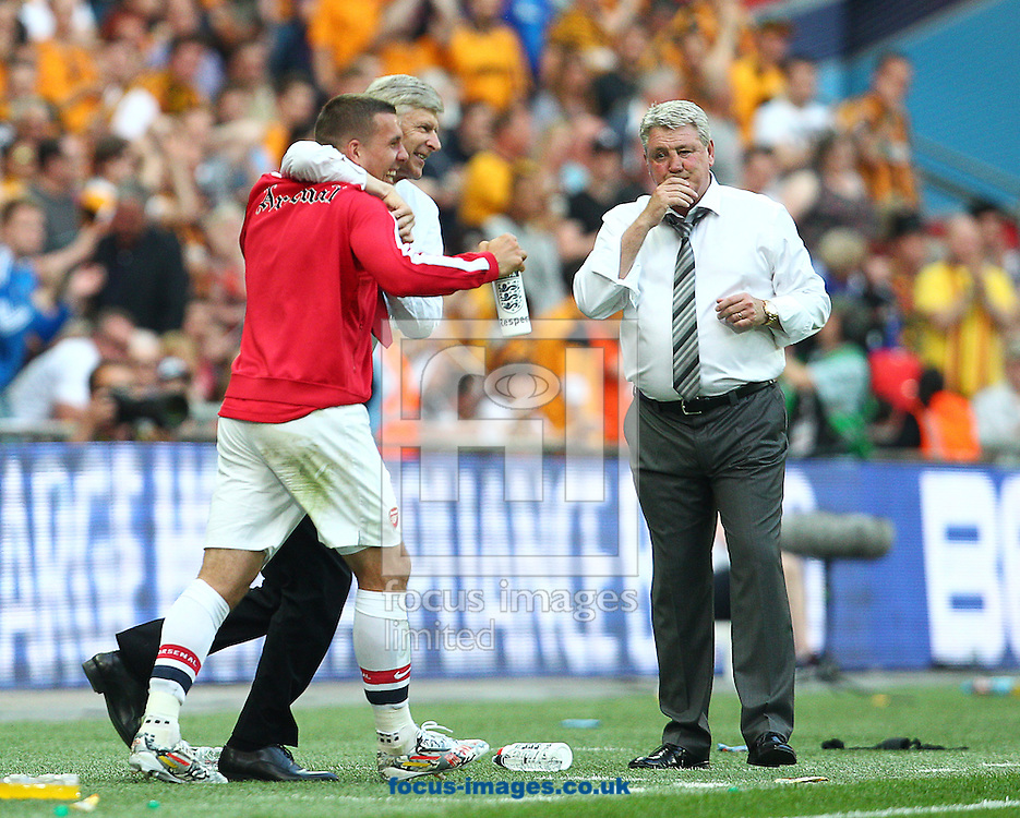 Ars&egrave;ne Wenger ( C ), Manager of Arsenal celebrates with Lukas Podolski ( L ) at the final whistle during the The FA Cup Final match at Wembley Stadium, London<br /> Picture by Paul Terry/Focus Images Ltd +44 7545 642257<br /> 17/05/2014