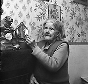 Limerick Widows Alms House. Mrs. Bridgit Riordan (93) lights her oil lamp in her room..28.03.1962