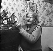 Limerick Widows Alms House. Mrs. Bridgit Riordan (93) lights her oil lamp in her room..28.03.1962