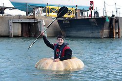 Pumpkin Boat. <br /> Artist Dmitri Galitzine celebrates after setting a new Guiness World record for the fastest hundred metres paddled in a Pumpkin boat at Trafalgar Wharf, Port Solent, Portsmouth, United Kingdom. Wednesday, 23rd October 2013. Picture by Matt Scott-Joynt / i-Images.<br /> UK OUT