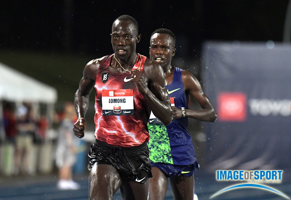 Jul 25, 2019; Des Moines, IA, USA;  Lopez Lomong defeats Shadrack Kipchirchir to win the 10,000m in a facility record 27:30.06 during the USATF Championships at Drake Stadium.