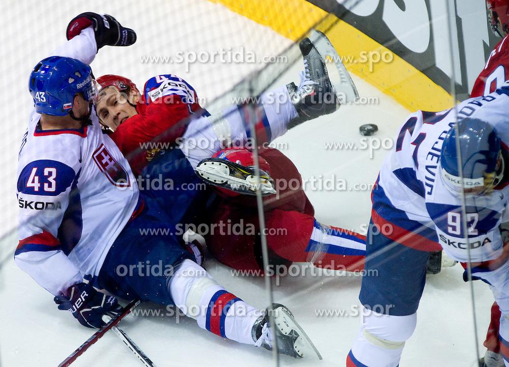 Tomas Surovy of Slovakia and Nikolai Belov of Russia during ice-hockey match between Russia and Slovakia of Group A of IIHF 2011 World Championship Slovakia, on May 3, 2011 in Orange Arena, Bratislava, Slovakia. (Photo By Vid Ponikvar / Sportida.com)