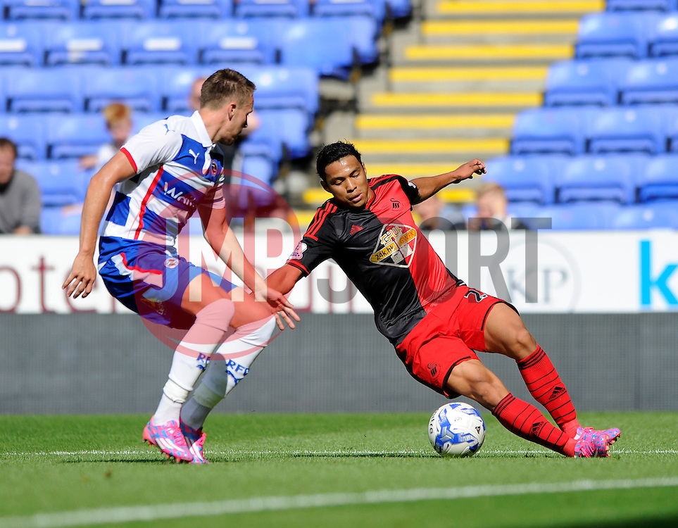 Swansea City's Jonathan de Guzman falls - Photo mandatory by-line: Dougie Allward/JMP - Mobile: 07966 386802 02/08/2014 - SPORT - FOOTBALL - Reading - Madejski Stadium - Reading v Swansea - Pre-Season Friendly