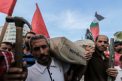 October 7, 2018 - Gaza City, The Gaza Strip, Palestine - Unemployed Palestinian workers take part in demonstration march  in Gaza city demanding jobs. The Gaza strip is experiencing a worsening jobs crisis. (Credit Image: © Mahmoud Khattab/Quds Net News via ZUMA Wire)