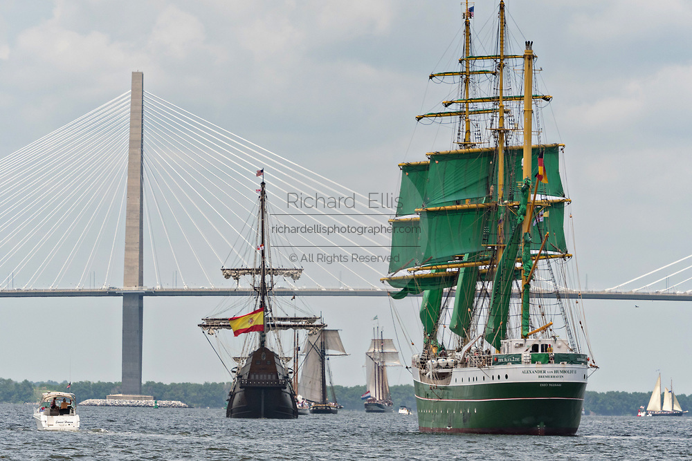 The German Barque Alexander von Humboldt II, Spanish Galleon Andalucia and other tall sailing ships pass the Ravenel Bridge during the parade of sails kicking off the Tall Ships Charleston festival May 18, 2017 in Charleston, South Carolina. The festival of tall sailing ships from around the world will spend three-days visiting historic Charleston.