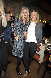 Left to right, sisters DONNA AIR and FRANCESCA AIR at a dinner in aid of the Soil Association held at Bumpkin, 102 Old Brompton Road, London SW7 on 11th March 2009.