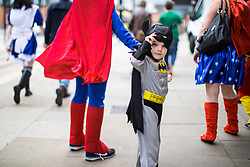 © Licensed to London News Pictures . 30/07/2017 . Manchester , UK . Batman (Maximillian Dowling) (four, from Stoke) . Cosplayers, families and guests at Comic Con at the Manchester Central Convention Centre . Photo credit : Joel Goodman/LNP