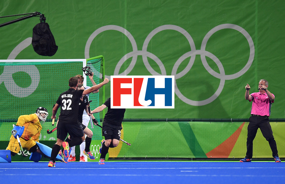 New Zealand's Shea McAleese (C) celebrates his team's second goal during the men's quarterfinal field hockey Germany vs New Zealand match of the Rio 2016 Olympics Games at the Olympic Hockey Centre in Rio de Janeiro on August 14, 2016. / AFP / MANAN VATSYAYANA        (Photo credit should read MANAN VATSYAYANA/AFP/Getty Images)