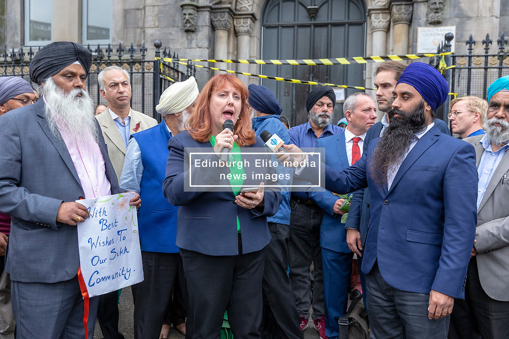 A Peace vigil has been held at a Sikh temple in the Leith district of Edinburgh. The vigil, called by the Muslim Women's Association of Edinburgh and supported by Stand up to Racism Edinburgh, follows a fire at the temple. A 49 year-old man has been charged over the incident.<br /> <br /> Pictured: Local MP, Deirdre Brock speaking during the vigil