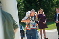 A man and woman embrace before burial services with full military honors, held for 12 veterans left unattended by family or friends Thursday, August 29, 2019 at Washington Crossing National Cemetery in Washington Crossing, Pennsylvania. Once a month, burials are held for veterans who have no family and their remains have never been claimed. Some vets remains have waited 12 years for burial. (Photo by William Thomas Cain / CAIN IMAGES)
