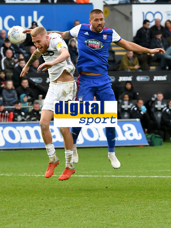 Football - 2018 / 2019 Sky Bet EFL Championship - Swansea City vs. Ipswich Town<br /> <br /> Oliver McBurnie Swansea City heads at goal, marked by Luke Chambers of Ipswich Town, at The Liberty Stadium.<br /> <br /> COLORSPORT/WINSTON BYNORTH