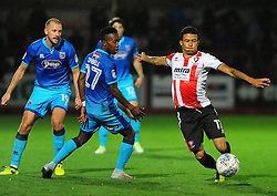 Jerell Sellars of Cheltenham Town tries to hold off Siriki Dembele of Grimsby Town- Mandatory by-line: Nizaam Jones/JMP- 17/10/2017 - FOOTBALL - LCI Rail Stadium - Cheltenham, England - Cheltenham Town v Grimsby Town - Sky Bet League Two