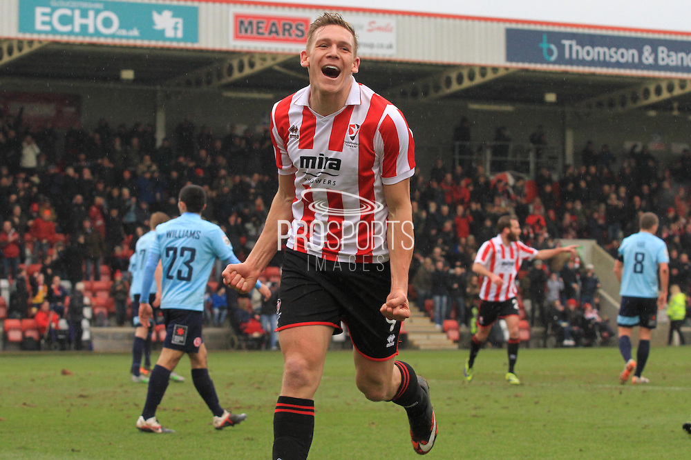 Danny Wright celebrates his opening goal during the Vanarama National League match between Cheltenham Town and Welling United at Whaddon Road, Cheltenham, England on 13 February 2016. Photo by Antony Thompson.