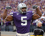 Kansas State running back Thomas Clayton show some muscle after a 20-yard game against Missouri at Bill Snyder Family Stadium in Manhattan, Kansas, November 19, 2005.  K-State defeated the Missouri Tigers 36-28.