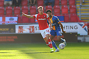 Rotherham United player Jamie Lindsay (16) and Shrewsbury Town player Josh Laurent (28) during the EFL Sky Bet League 1 match between Rotherham United and Shrewsbury Town at the AESSEAL New York Stadium, Rotherham, England on 21 September 2019.