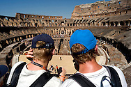 Roma 5 Agosto 2015<br /> Grande affluenza di visitatori italiani e stranieri al Colosseo,  sono circa  22000 le persone che ogni giorno dall'inizio della stagione turistica, hanno visitato l'antico anfiteatro e l'area archeologica centrale. Il monumento pi&ugrave; celebre della Capitale si conferma cos&igrave; tra i luoghi pi&ugrave; amati dai turisti italiani e stranieri. Il ministero dei Beni culturali a stanziato 18,5 milioni di euri per ricostruire  l&rsquo;arena del Colosseo come nell&rsquo;Ottocento.<br /> Rome August 5, 2015<br /> Large influx of Italian and foreign visitors to the Colosseum, are about 22000 people every day from the beginning of the tourist season, they visited the ancient amphitheater and the archaeological center. The most famous monument of the capital is confirmed as one of the most loved by Italian and foreign tourists. The Ministry of Culture it allocated 18.5 million  euros to rebuild the arena of the Coliseum as in the nineteenth century.