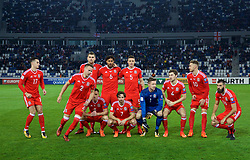 TBILSI, GEORGIA - Friday, October 6, 2017: Wales players line-up for a team group photograph before the 2018 FIFA World Cup Qualifying Group D match between Georgia and Wales at the Boris Paichadze Dinamo Arena. Back row L-R: Sam Vokes, captain Ashley Williams, James Chester. Front row L-R: Tom Lawrence, Chris Gunter, Andy King, Joe Allen, goalkeeper Wayne Hennessey, Ben Davies, Aaron Ramsey and Joe Ledley. (Pic by David Rawcliffe/Propaganda)