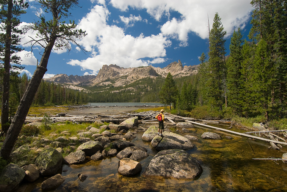 Idaho. Sawtooth National Recreation Area. Hell Roaring Lake. Hiker at headwaters of Hell Roaring Creek. MR