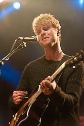 © Licensed to London News Pictures. 12/11/2013. London, UK.   Kodaline performing live at The Forum. In this picture - Steve Garrigan.  Kodaline are a Dublin-based Irish rock band composed of members Steve Garrigan (Vocals, rhythm guitar, harmonica, keyboards), Mark Prendergast (Lead guitar, vocals, keyboards), Vinny May (Drums, percussion, vocals), and Jason Boland (Bass guitar, vocals). Photo credit : Richard Isaac/LNP