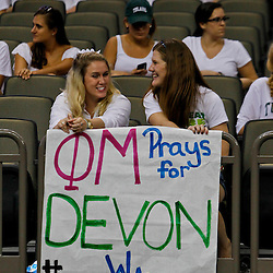 September 22, 2012; New Orleans, LA, USA; Tulane Green Wave students Elizabeth Bobo and Lauren Polson show off a sign in support of injured safety Devon Walker (18) during the second half of a game against the Ole Miss Rebels at the Mercedes-Benz Superdome. Ole Miss defeated Tulane 39-0. Mandatory Credit: Derick E. Hingle-US PRESSWIRE