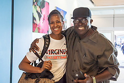 St. Thomas resident Raymond Frett welcomes his daughter Asst. Coach La'Keisha Frett back home.  The ladies of the University of Virginia's Basketball Team arrive for the Paradise Jam Tournament  in St. Thomas at Cyril E. King Airport.  24 November 2015.  © Aisha-Zakiya Boyd