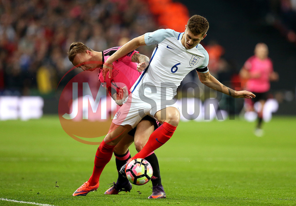 John Stones of England is tackled by Leigh Griffiths of Scotland - Mandatory by-line: Robbie Stephenson/JMP - 11/11/2016 - FOOTBALL - Wembley Stadium - London, United Kingdom - England v Scotland - European World Cup Qualifiers
