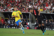 Peru defender Carlos Zambrano (15) heads the ball as Brazil midfielder Phillippe Coutinho (11) watches during an international friendly soccer match, Tuesday, Sept. 10, 2019, in Los Angeles. Peru defeated Brazil 1-0.
