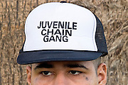 "24 MARCH 2004 - PHOENIX, AZ, USA: A member of the Maricopa County Jail's Juvenile Chain Gang at a worksite in Phoenix, AZ, March 24, 2004. The juveniles volunteer to serve Maricpoa County Sheriff Joe Arpaio's chain gang. The sheriff, who claims to be ""the toughest sheriff in America,"" has chain gangs in both the men's and women's jails and now has a chain gang for juveniles sentenced and serving time as adults in the county jail system. The sheriff claims it is the only juvenile chain gang in the country.   PHOTO BY JACK KURTZ"