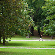 Woman walking in Humlegarden Park in Ostermalm, Stockholm, Sweden