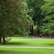 Woman walking in Humlegarden Park in Ostermalm, Stockholm, Sweden