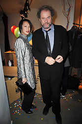 MIKE FIGGIS and ROSEY CHAN at the launch party of 'Songs For Sorrow' hosted by Alber Elbaz and Mika held at Lanvin, 32 Savile Row, London on 11th November 2009.