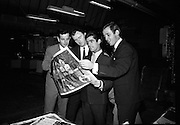 Dickie Rock ( right) and other members of the Miami Showband check their pictures at Baily Gibson Printers. .02.12.1964