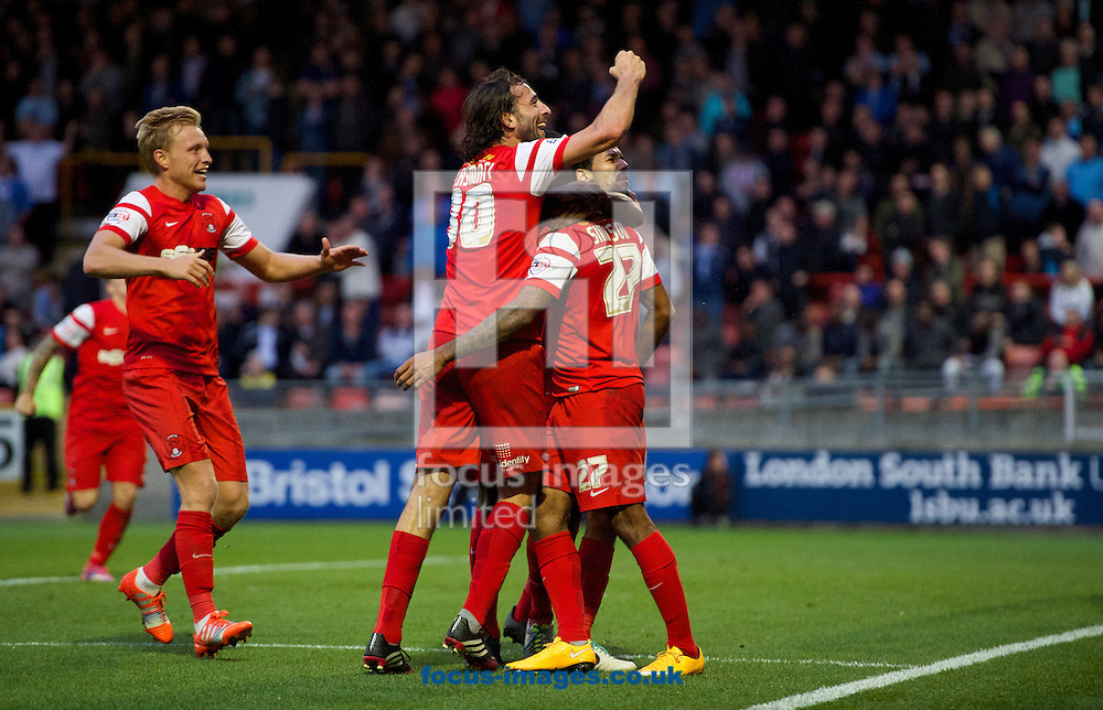 Josh Wright of Leyton Orient (left) celebrates with Gianvito Plasmati  and goalscorer Jay Simpson (27) during the Sky Bet League 1 match at the Matchroom Stadium, London<br /> Picture by Alan Stanford/Focus Images Ltd +44 7915 056117<br /> 01/11/2014