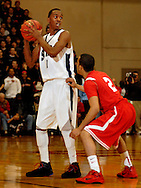 5 MARCH 2011 -- NORMANDY, Mo -- BJ Young of McCluer North High School prepares to drive past Chaminde College Prep's Solomon Bennett (2) during the MSHSAA Class 5 boys basketball quarterfinals at Mark Twain Hall on the University of Missouri - St. Louis campus in Normandy, Mo. Saturday, March 5, 2011. The Stars upset the Red Devils 57-56 to advance to MSHSAA semifinals. Image © copyright 2011 Sid Hastings.