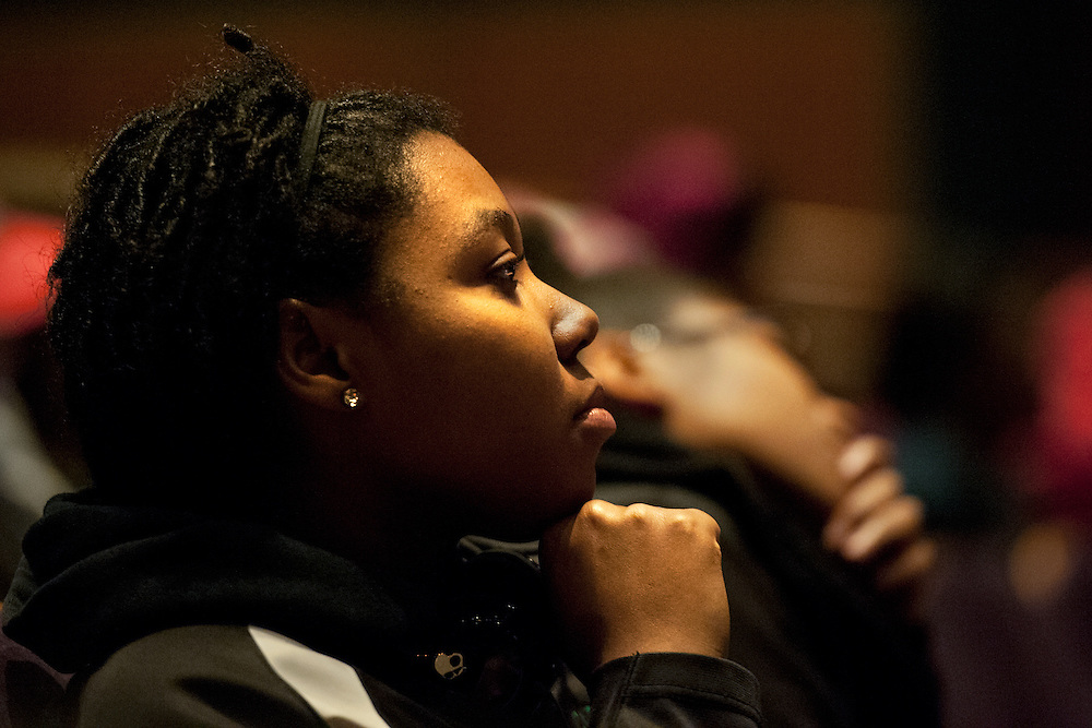 Erin Johnson  watches itently as a poem is performed during the  Creative Arts as Activism event which was held in Baker Center Theatre on tuesday in honor of Dr. Martn Luther King. The event featured several performers, each of whom dealt with racial issues through song, poetry, dance and artwork. Photo by: Ross Brinkerhoff.