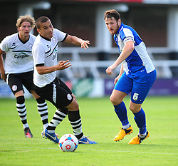 Bristol Rovers' Tom Parkes passes Hereford United's Rod McDonald - Photo mandatory by-line: Dougie Allward/JMP - Tel: Mobile: 07966 386802 16/07/2013 - SPORT - FOOTBALL - Bristol -  Hereford United V Bristol Rovers - Pre Season Friendly