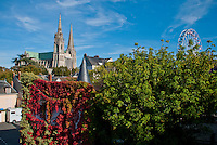 Our Lady of Chartres Cathedral, Chartres, France. Picturesque view of Chartres including the town, cathedral and contrasting ferris wheel.