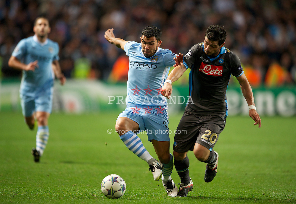 MANCHESTER, ENGLAND - Wednesday, September 14, 2011: Manchester City's Carlos Tevez in action against SSC Napoli's Blerim Dzemaili during the UEFA Champions League Group A match at the City of Manchester Stadium. (Photo by Chris Brunskill/Propaganda)
