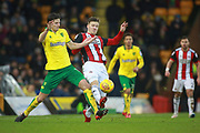 Sheffield United's Lee Evans and Norwich City's Timm Klose during the EFL Sky Bet Championship match between Norwich City and Sheffield Utd at Carrow Road, Norwich, England on 20 January 2018. Photo by John Marsh.