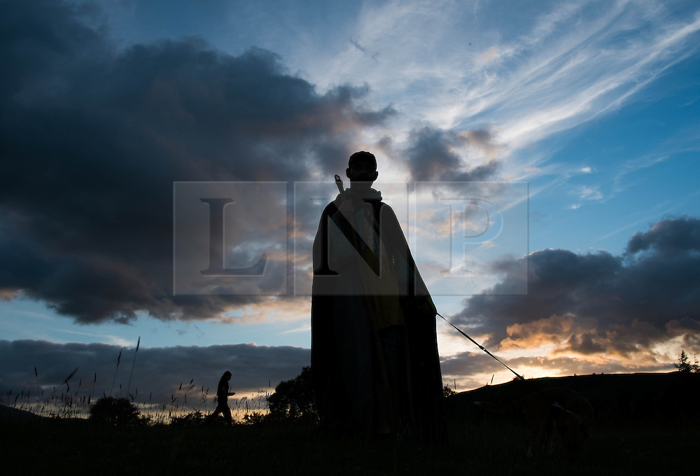 © Licensed to London News Pictures. <br /> 20/06/2014. <br /> <br /> Castlerigg Stone circle, Cumbria, England<br /> <br /> A druid at the ancient site of Castlerigg Stone Circle near Keswick in Cumbria on the evening of the Summer Solstice.<br /> <br /> Photo credit : Ian Forsyth/LNP