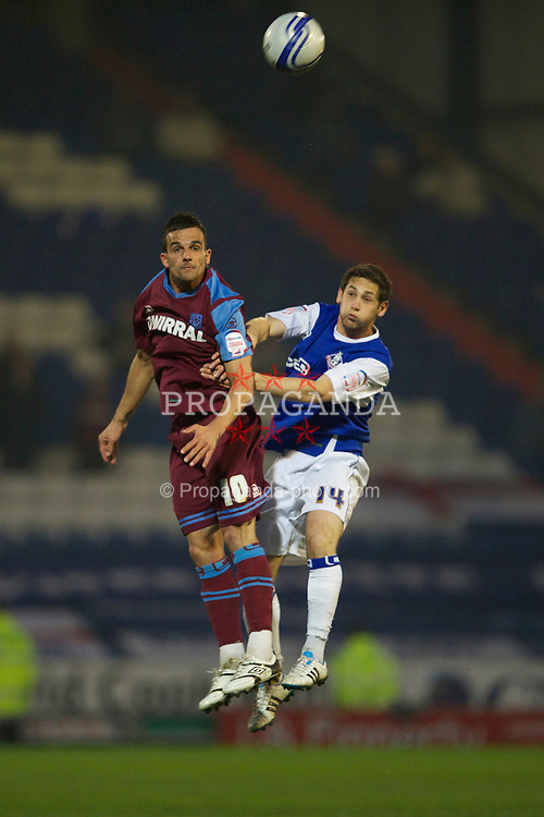 OLDHAM, ENGLAND - Monday, March 28, 2011: Tranmere Rovers' Robbie Weir and Oldham Athletic's Dean Furman during the Football League One match at Boundary Park. (Photo by David Rawcliffe/Propaganda)
