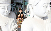 Marble carvers and Buddha statues. Mandalay, Myanmar