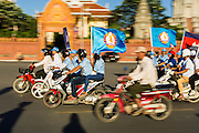 29 JUNE 2013 - PHNOM PENH, CAMBODIA:   People on motorcycles campaign for the Cambodia People's Party in Phnom Penh. The CPP, party of long serving Prime Minister Hun Sen, is expected to win the election,which is scheduled for July 28.    PHOTO BY JACK KURTZ