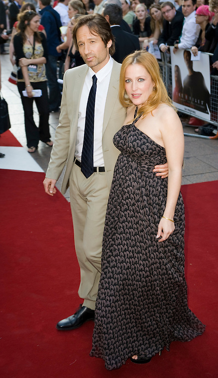 "London, Leicester Square  July 30th  Gillian Aderson  and David Duchovny arrive  at the uk film premiere of ""The X Files I want to believe"" at the Empire Cinema in Leicester Square"