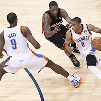 14 June 2012: Oklahoma City Thunder point guard Russell Westbrook (0) drives by Miami Heat point guard Mario Chalmers (15) on a screen set by Oklahoma City Thunder power forward Serge Ibaka (9) during the Miami Heat 100-96 victory over the Oklahoma City Thunder, in Game 2 of the 2012 NBA Finals, at the Chesapeake Energy Arena, Oklahoma City, Oklahoma, USA.