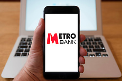 Using iPhone smart phone to display website logo of Metro Bank UK retail Bank
